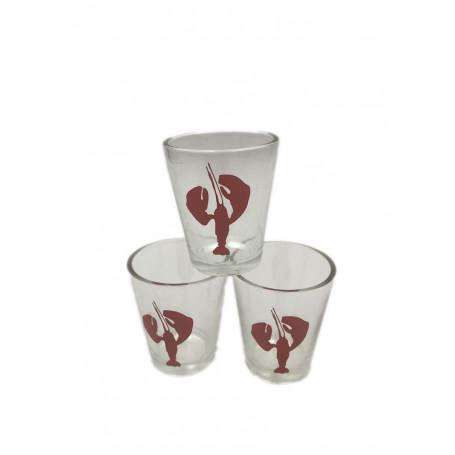 transparenta snapsglas av glas, med en röd silhouette av en kräfta.