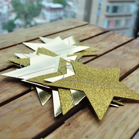 Stjärn girlang i guld