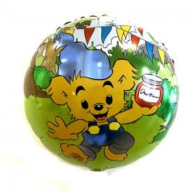 Stor fin heliumballong i grön med Bamse på kalas dekorerade med girlang och ballonger.