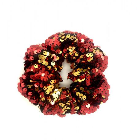 Scrunchie med paljetter i rött och guld.