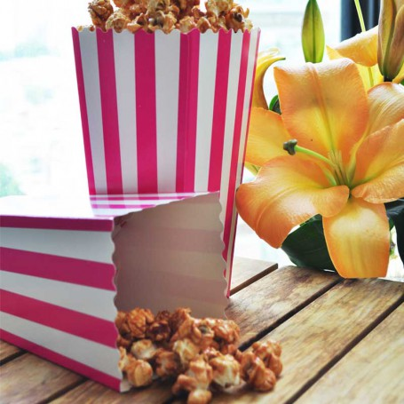 popcornboxar i rosa och vitt.