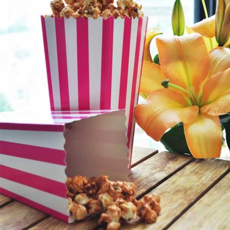 Popcornskål i rosa och vitt.