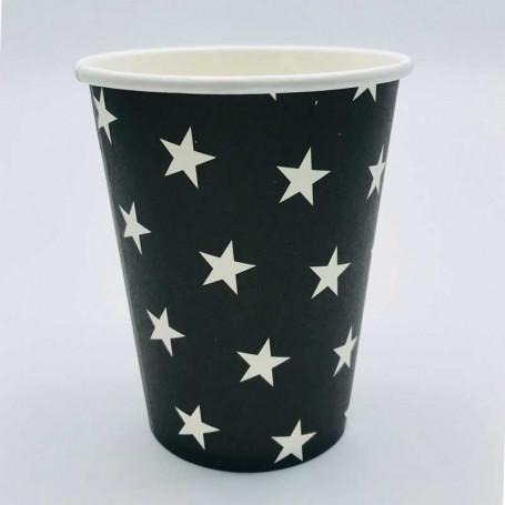 Svarta pappersmuggar med vita stjärnor.