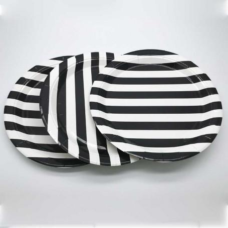 Papperstallrikar med vita och svarta ränder.